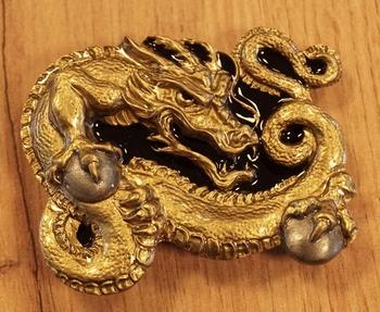 """Buckle  """" Keltische draak """"  zwart / goudkleurig"""