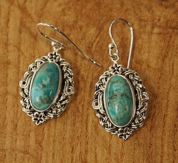 """Zilveren oorhangers  """" Bloem met turquoise stenen """""""