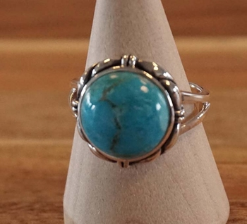 """Zilveren ring  """" Turquoise steen met sierrand """""""