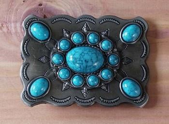 "Buckle "" Turquoise stenen in schild met sierwerk """