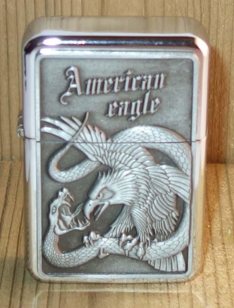 "Aansteker "" American eagle ""  Adelaar + slang  Zilverkleurig"