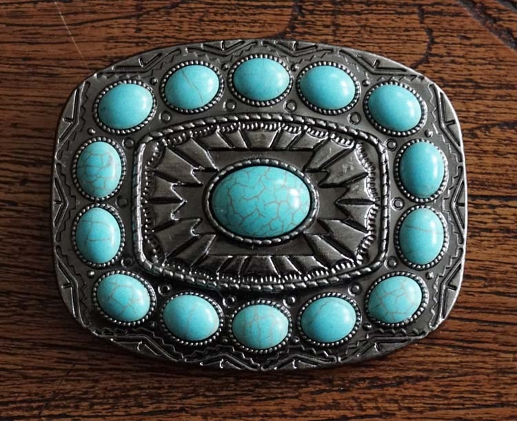 """Buckle """" Grote en kleine turquoise stenen """" nikkel kleurig"""