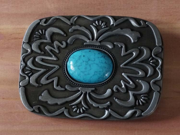 """Buckle """" Turquoise steen in schild met sierwerk """""""