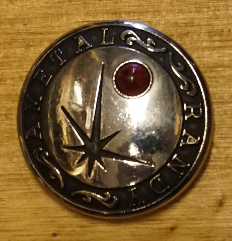 Concho met ster met rode steen