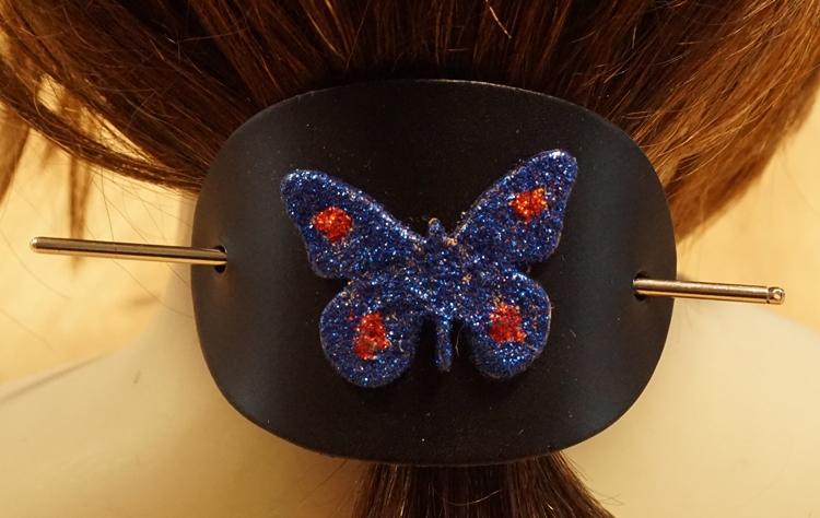 """Leren haarspeld  """" Vlinder blauw / rood glitter """""""