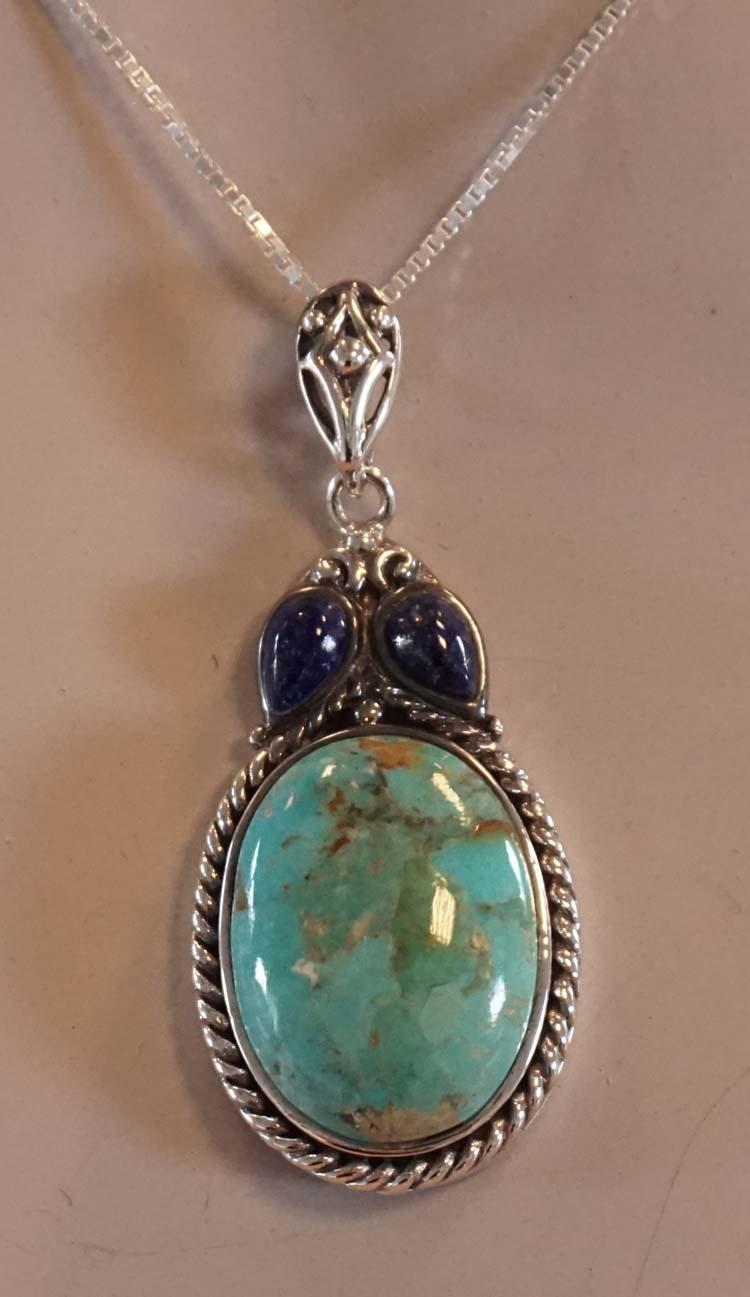 """Zilveren hanger """" Ovaal turquoise met 2 donker blauw stenen"""