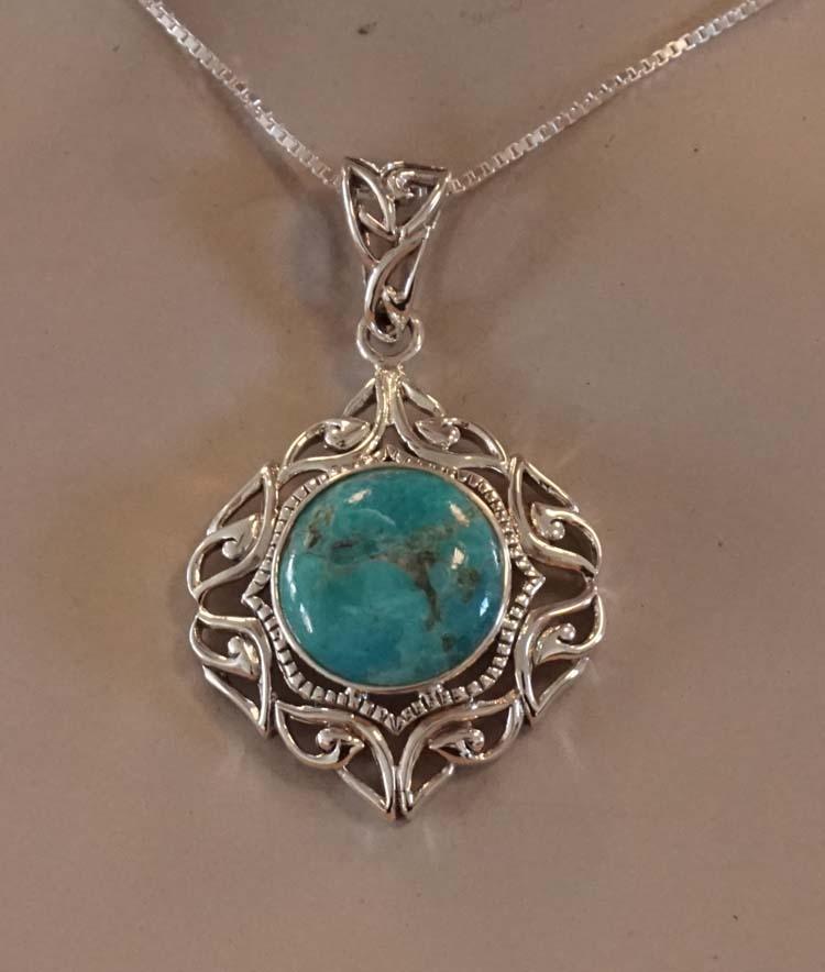 """Zilveren hanger """" Sierwerk met turquoise steen """""""