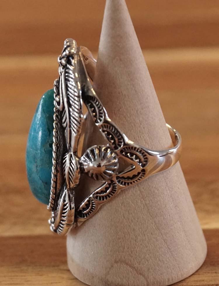 """Zilveren ring  """" Bladeren + bloemen met turquoise steen """""""