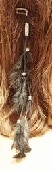 Haarkam met koord en zwarte veren